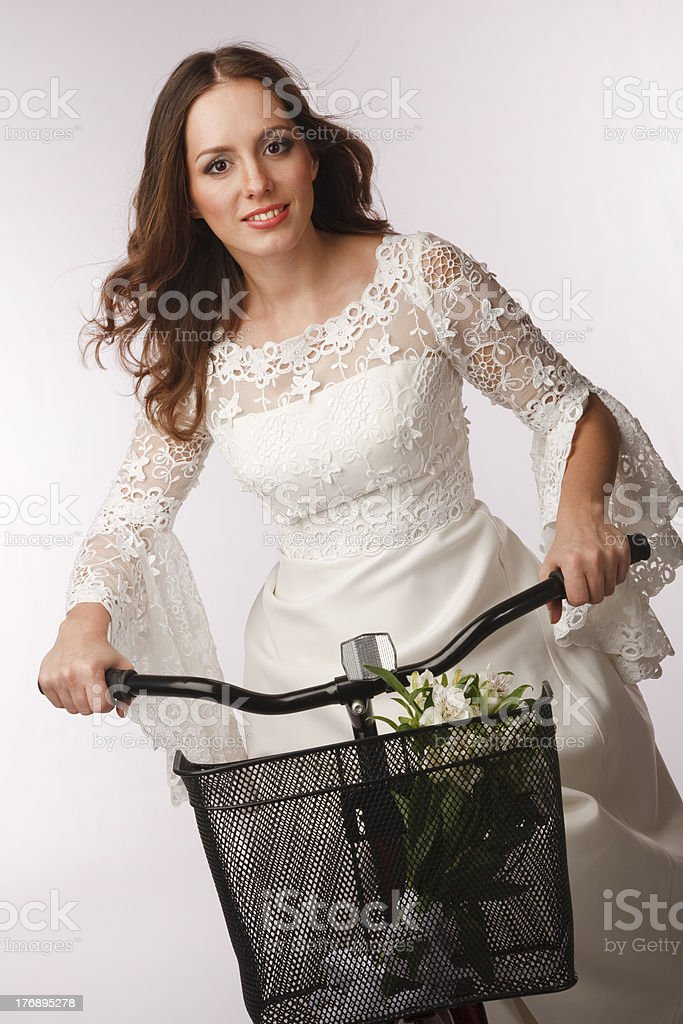 Bride cycling away royalty-free stock photo