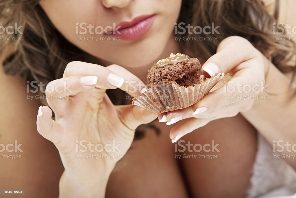 Bride eating muffin stock photo