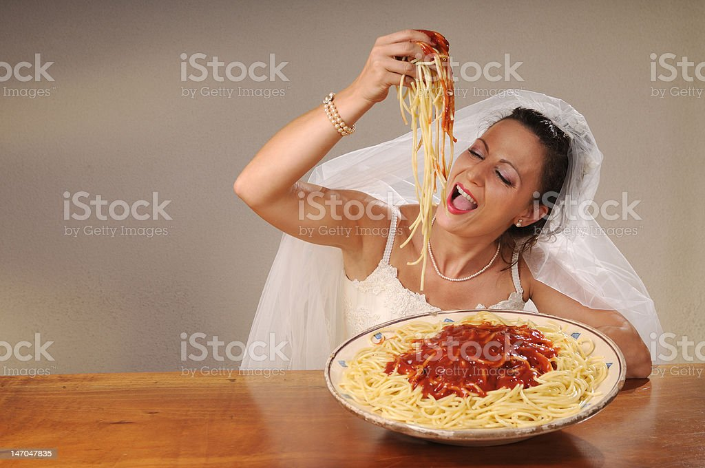 bride eats spaghetti royalty-free stock photo