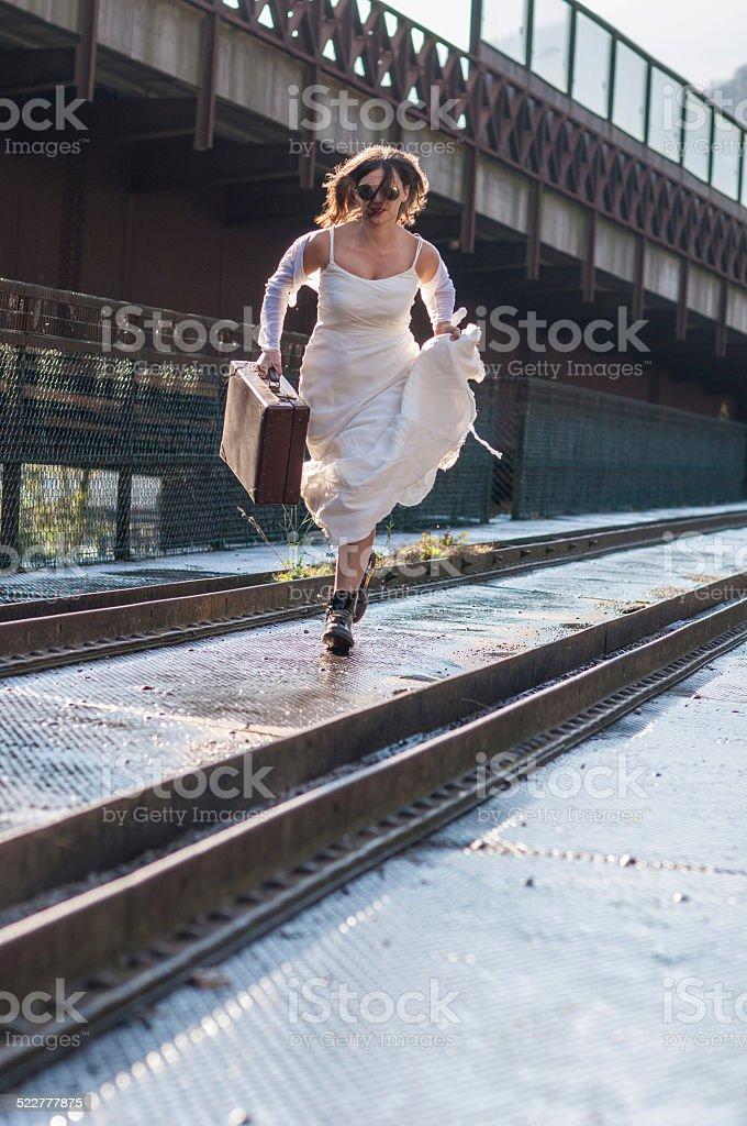 bride escaping stock photo