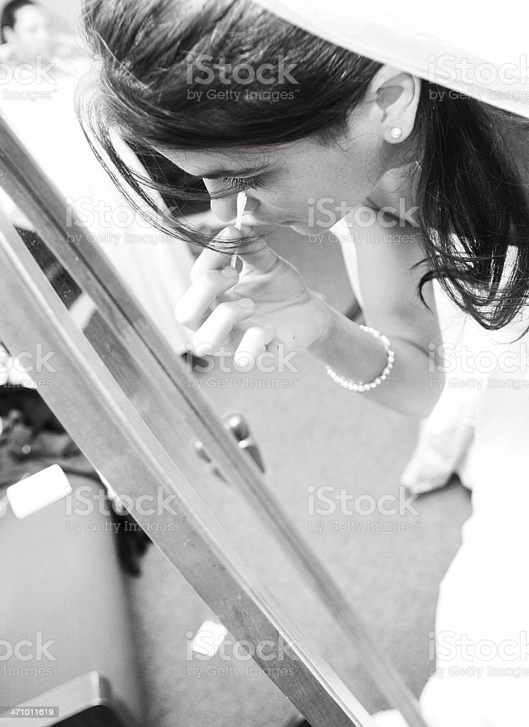 Bride Fixing her Makeup for the Wedding royalty-free stock photo