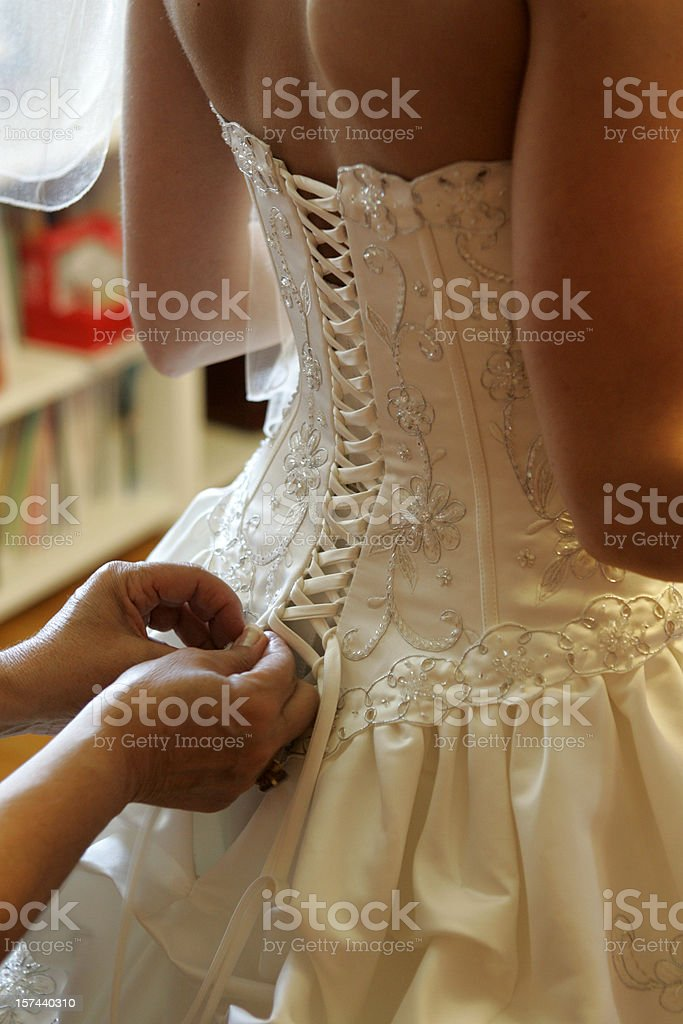 Bride getting dressed royalty-free stock photo