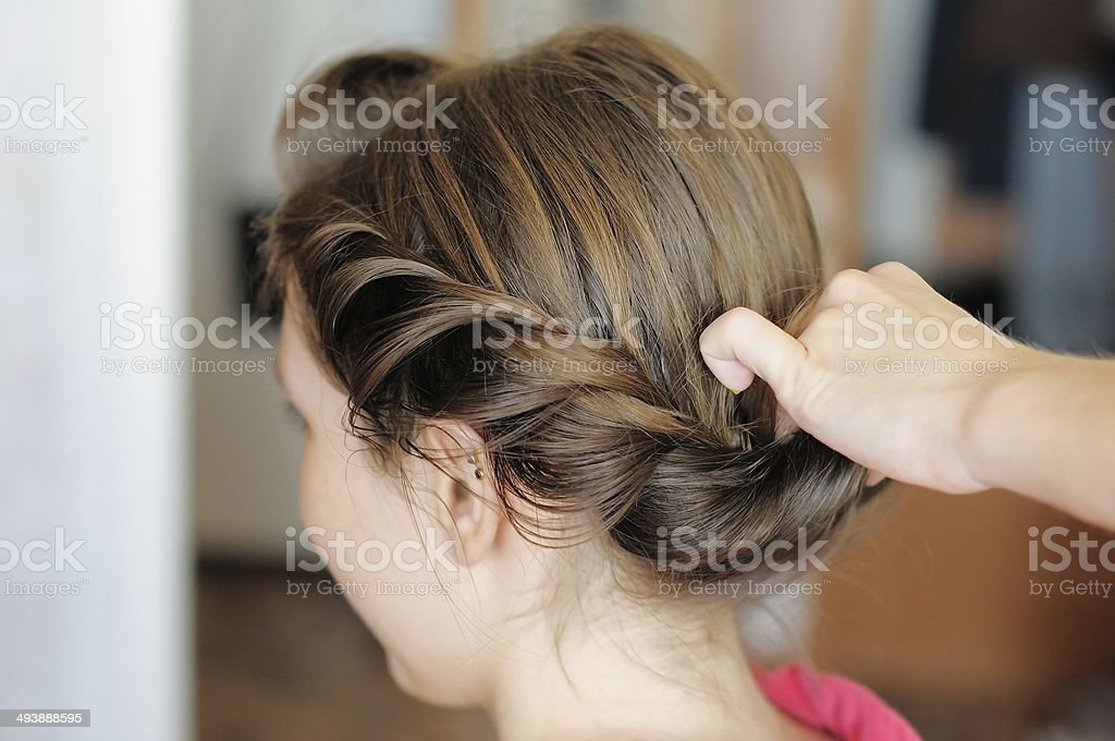 Bride getting her hair done stock photo