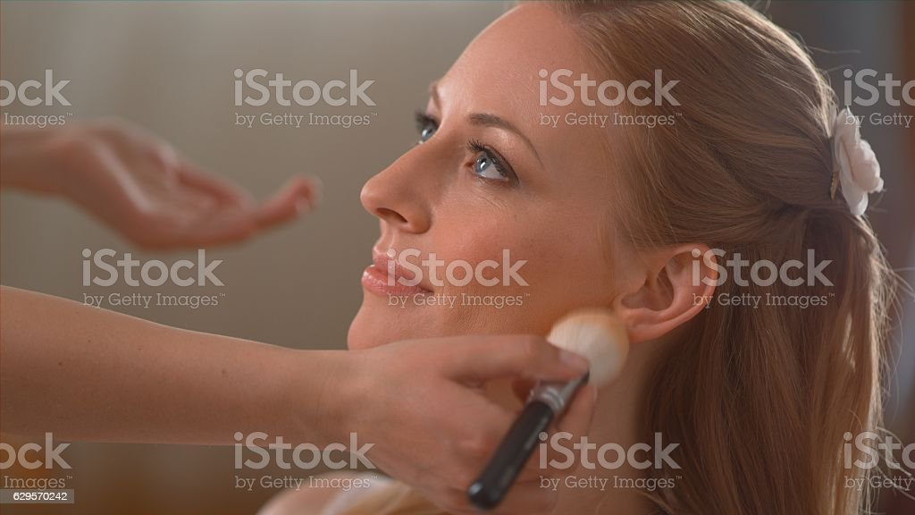 Bride getting make-up stock photo