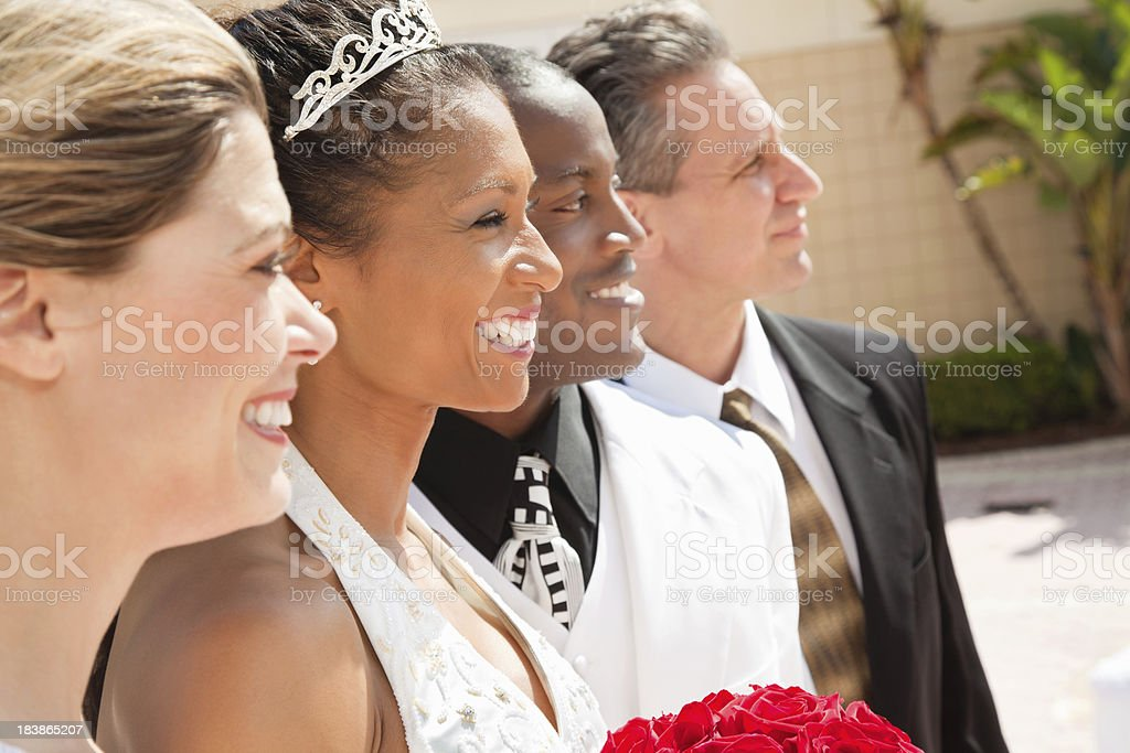 Bride Groom and Party Looking Out During Outdoor Wedding royalty-free stock photo