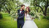 Bride & groom posing whith pots