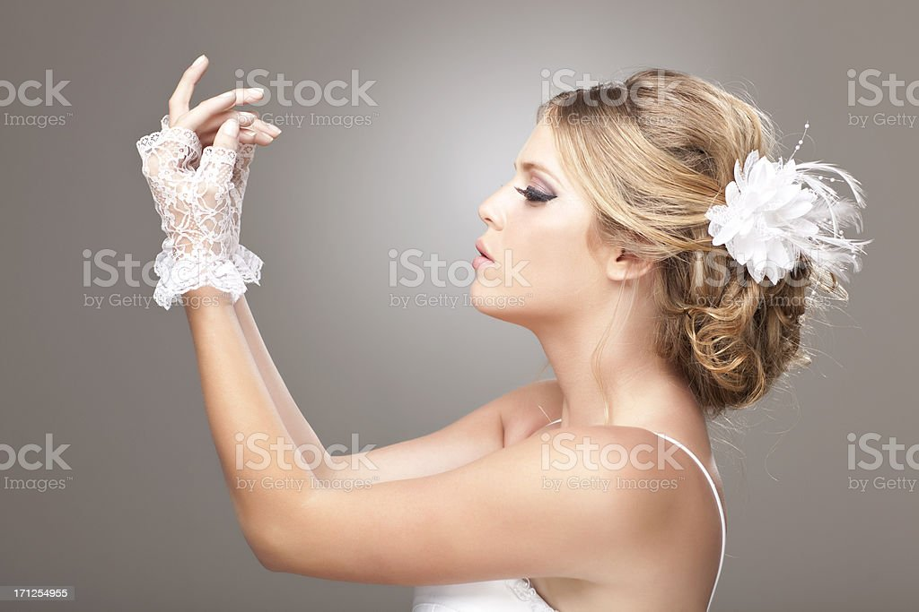 Bride hairstyle and lace gloves. royalty-free stock photo