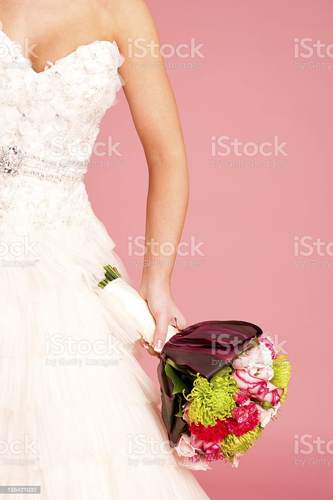 Bride hand holding floral bouquet royalty-free stock photo