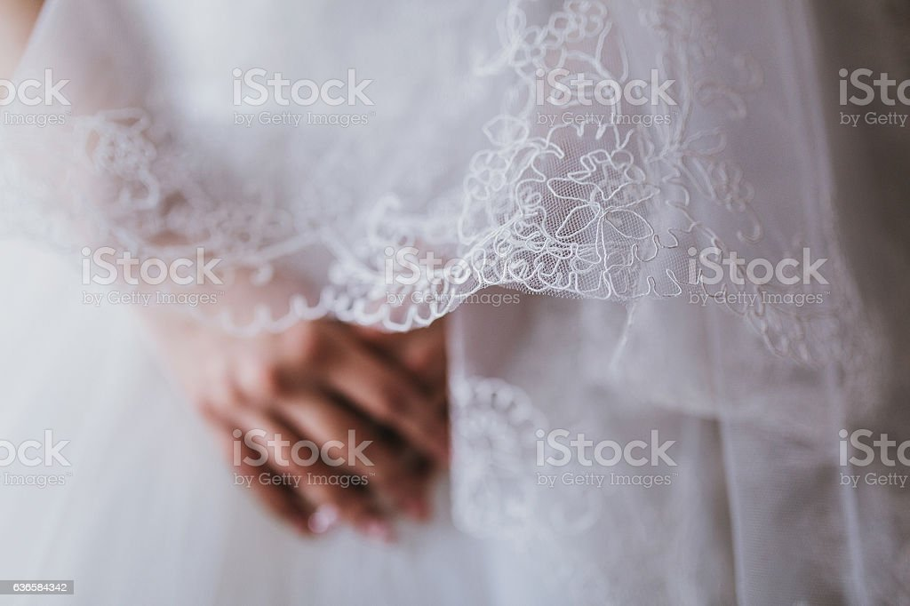 Bride hands on white dress,ready for marriage ceremony, Waiting stock photo