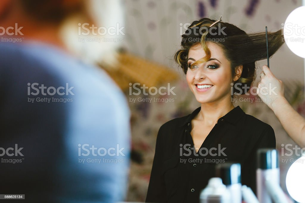 Bride having her hair done stock photo
