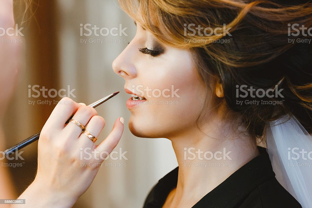 Bride having her make-up done stock photo