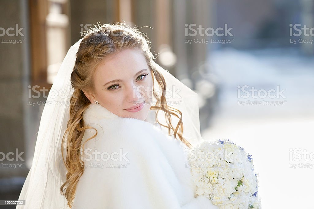 Bride hold bunch of flowers royalty-free stock photo
