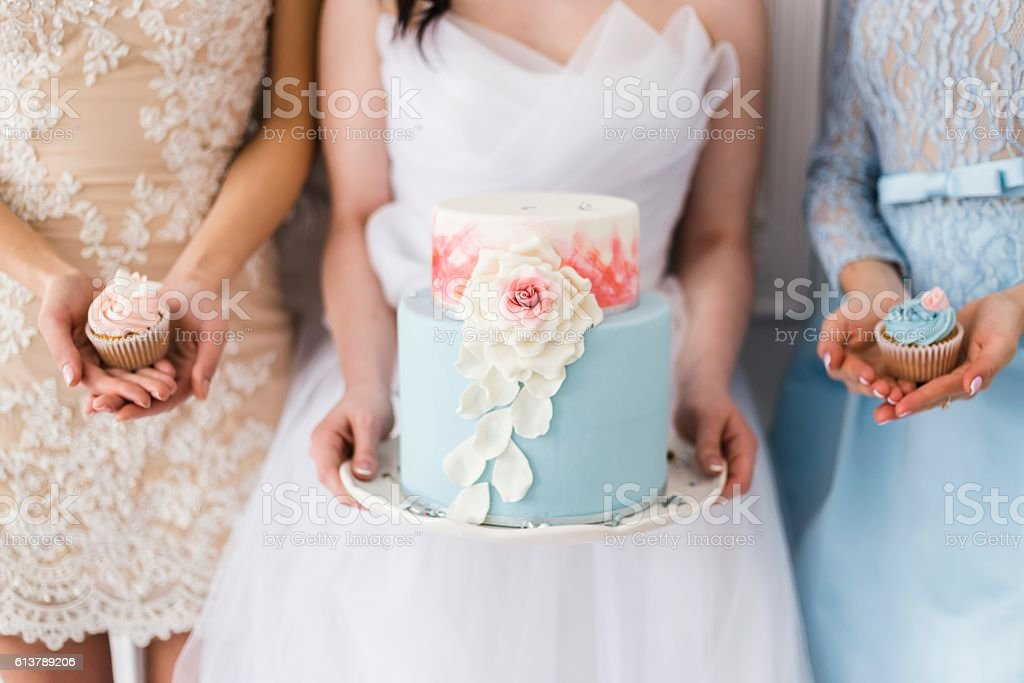 Bride holding a beautiful wedding cake stock photo