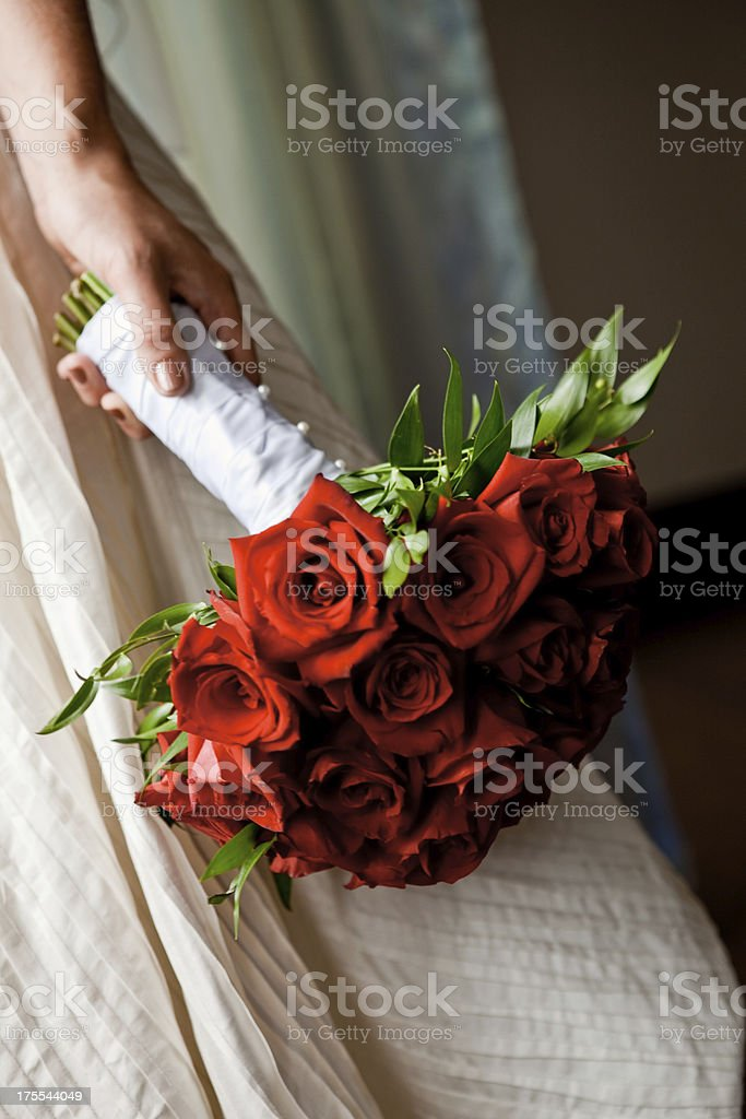 Bride Holding Beautiful Red Rose Floral Arrangement Bouquet Close Up royalty-free stock photo