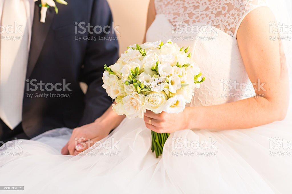 Bride holding big bridal bouquet on wedding ceremony stock photo