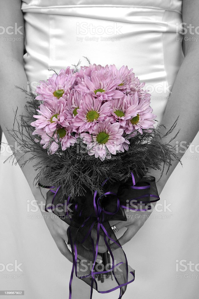 Bride holding bouquet with picture in black and white but flower royalty-free stock photo