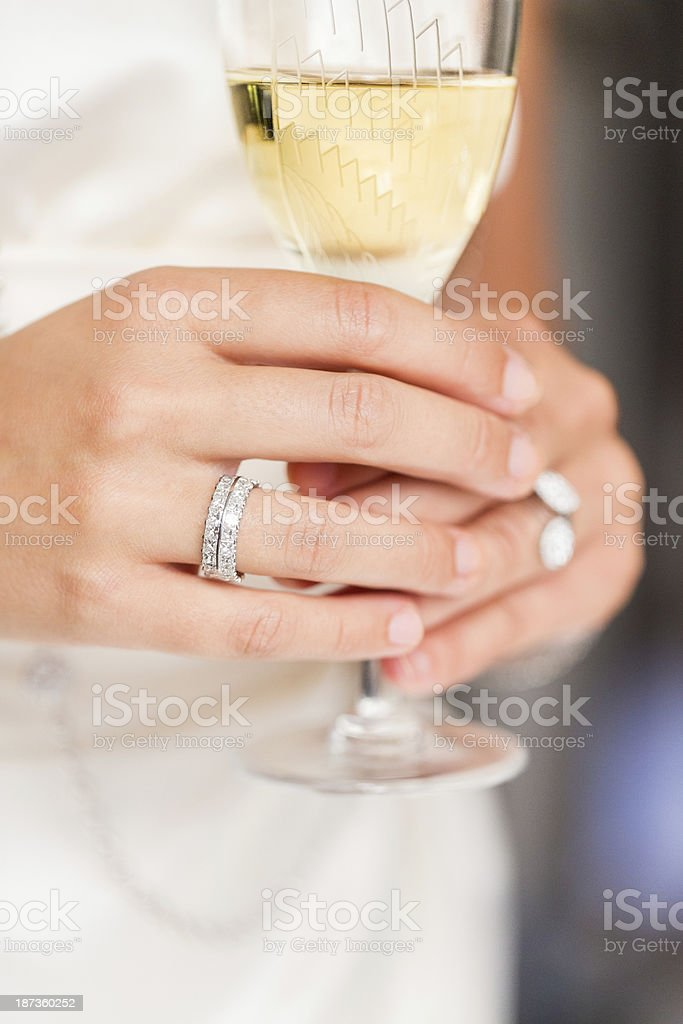 Bride Holding Champagne Glass on her Wedding Day royalty-free stock photo