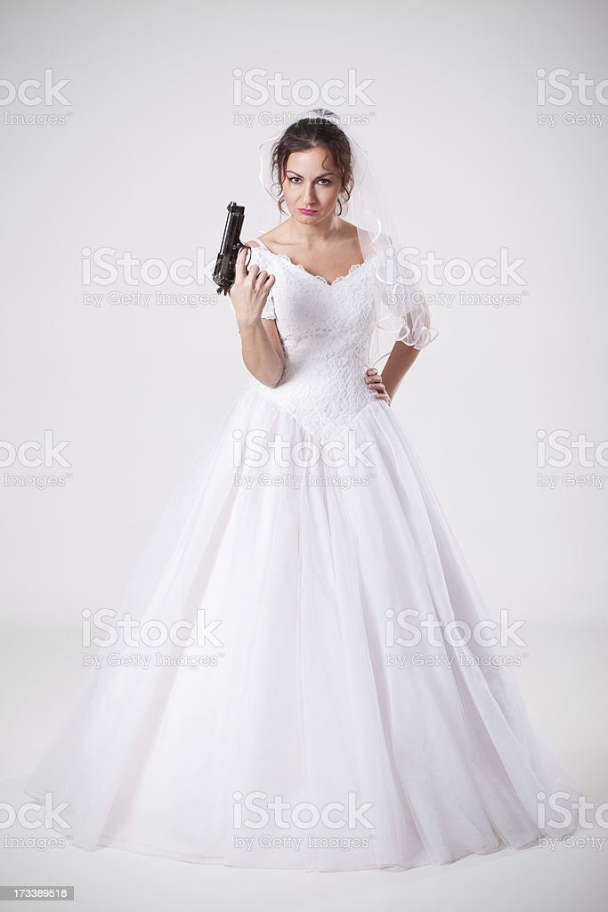 Bride holding gun royalty-free stock photo