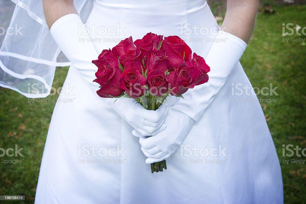 bride holding roses royalty-free stock photo