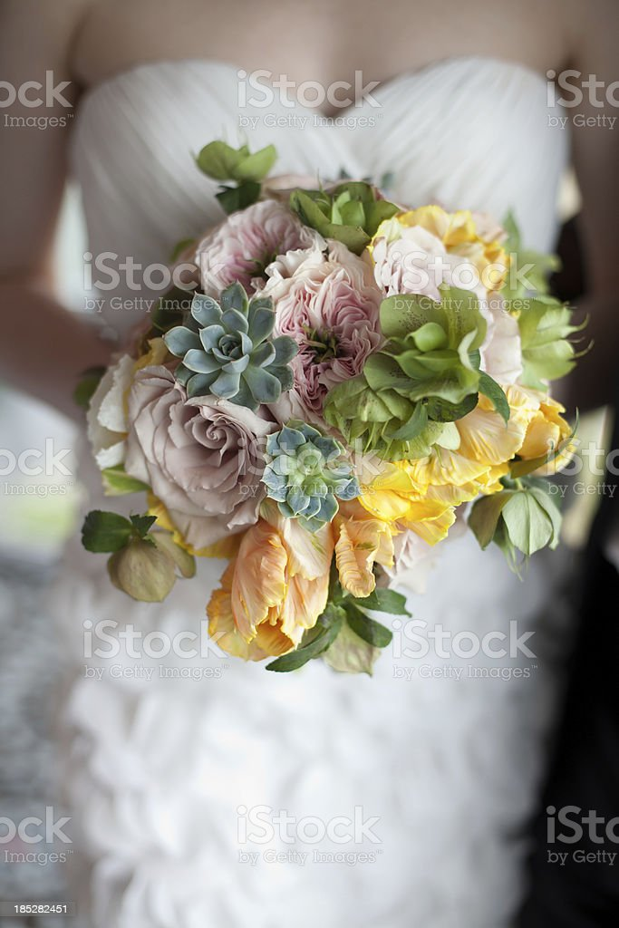 Bride holding springtime bouquet stock photo
