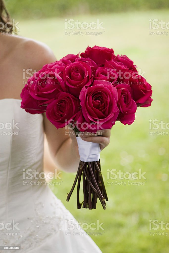 Bride holding the Bouquet of Red Roses with Left Hand royalty-free stock photo
