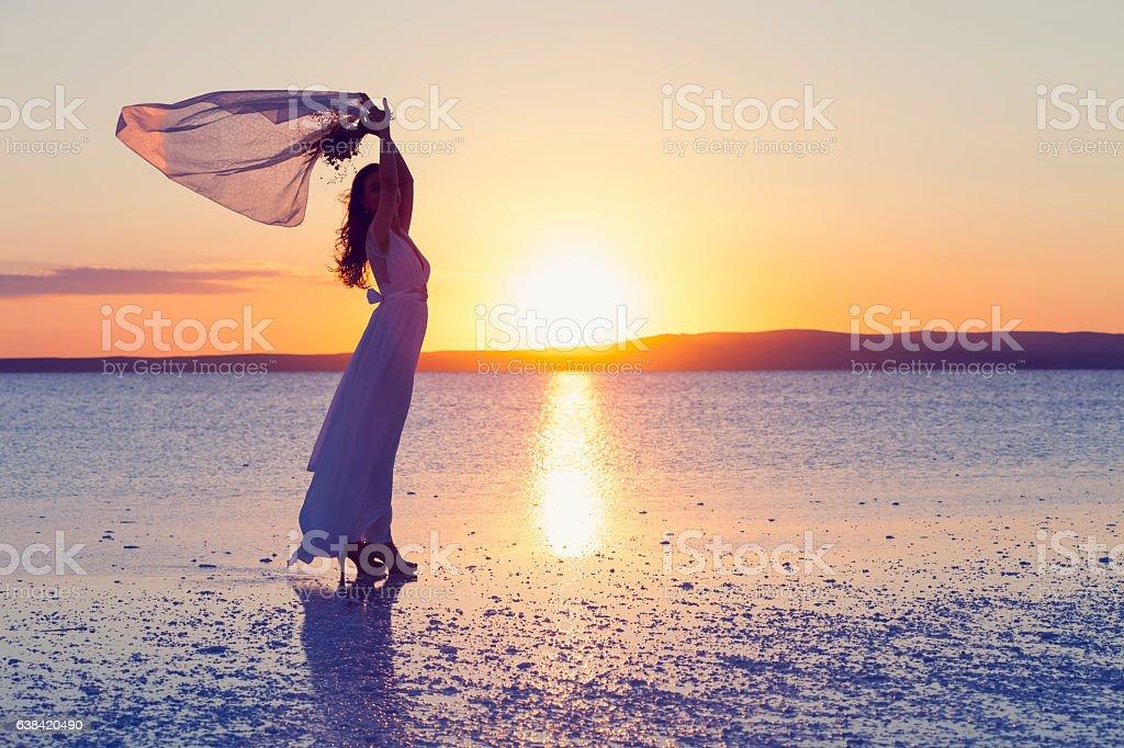 Bride holding the flower in Salt lake, Turkey stock photo