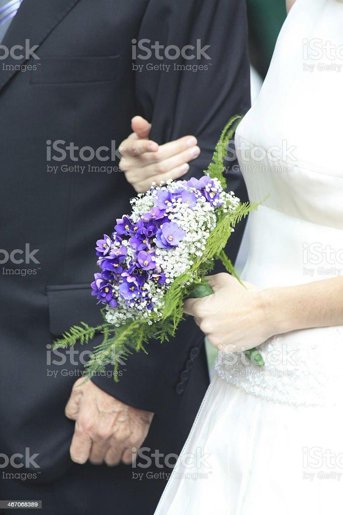 Bride holding wedding bouquet royalty-free stock photo