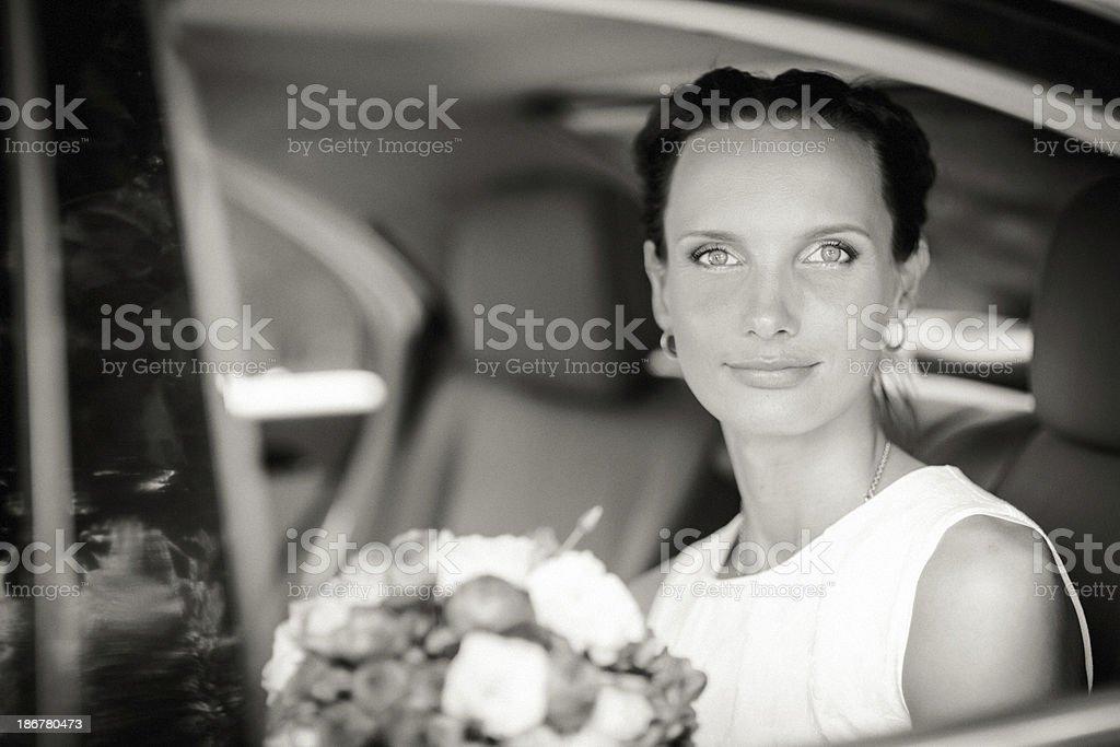 Bride in a wedding car royalty-free stock photo