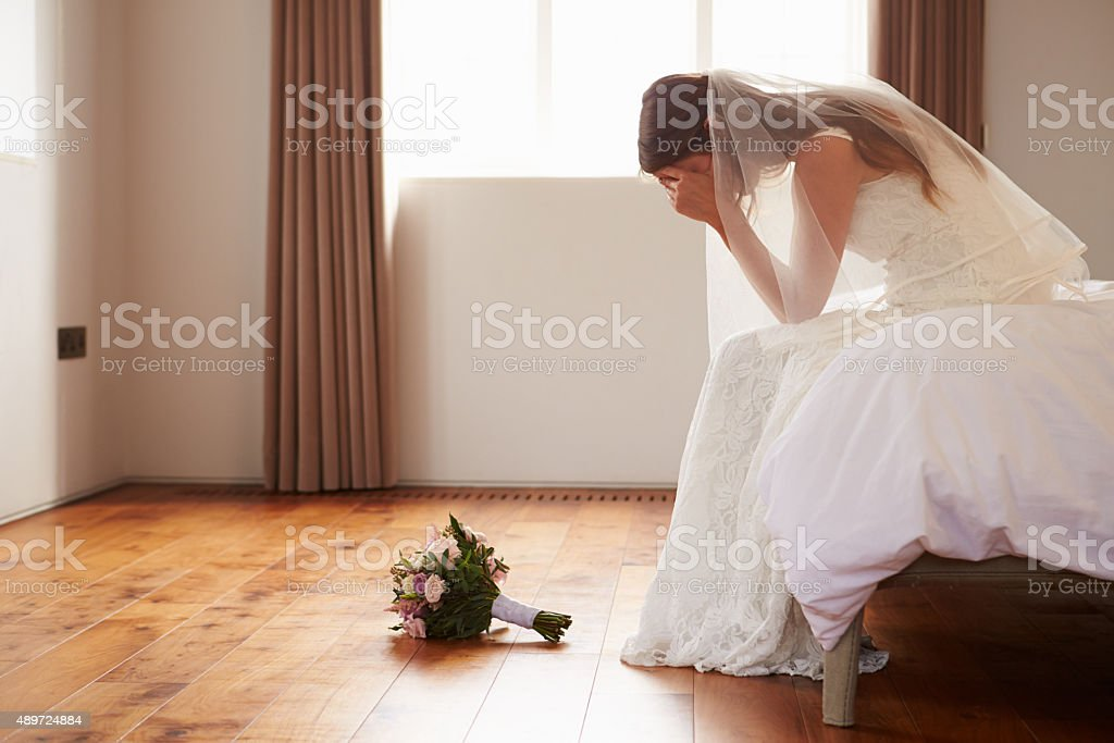 Bride In Bedroom Having Second Thoughts Before Wedding stock photo