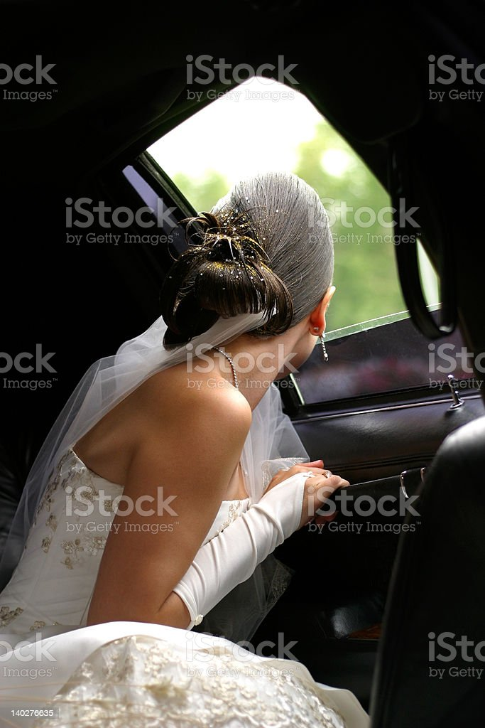 Bride in car royalty-free stock photo