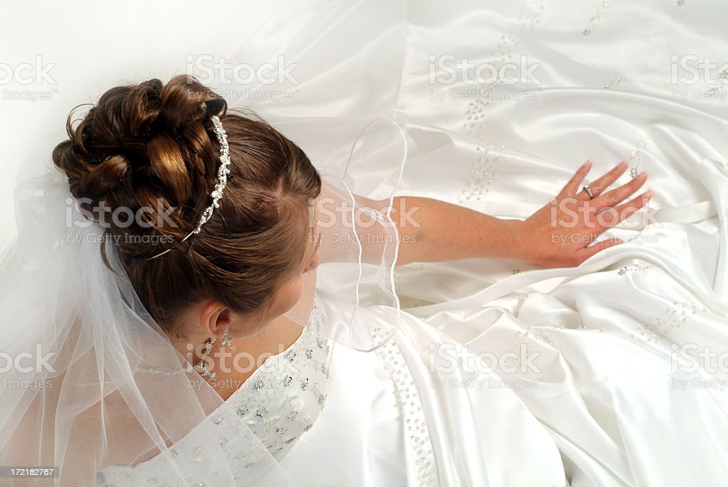 Bride in Gown Looking Down at Her Engagement Ring royalty-free stock photo