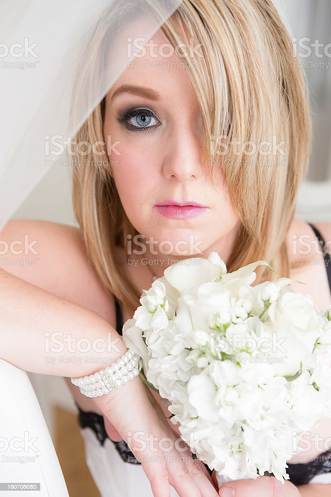 Bride in lingerie sitting on chair royalty-free stock photo