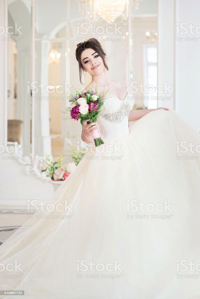 Bride in luxury interior in palace. Wedding, attractive brunette stock photo