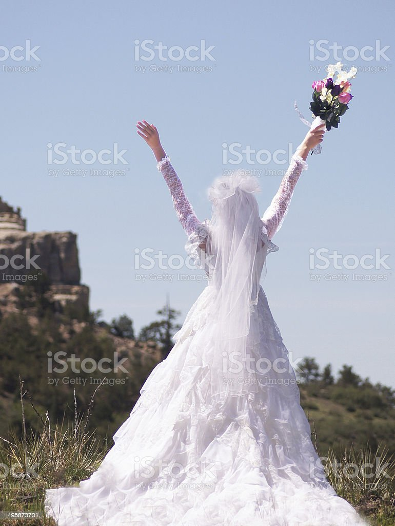 Bride In Natural Setting with Lifted Hands stock photo