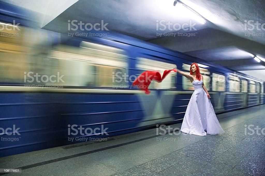 bride in subway station stock photo