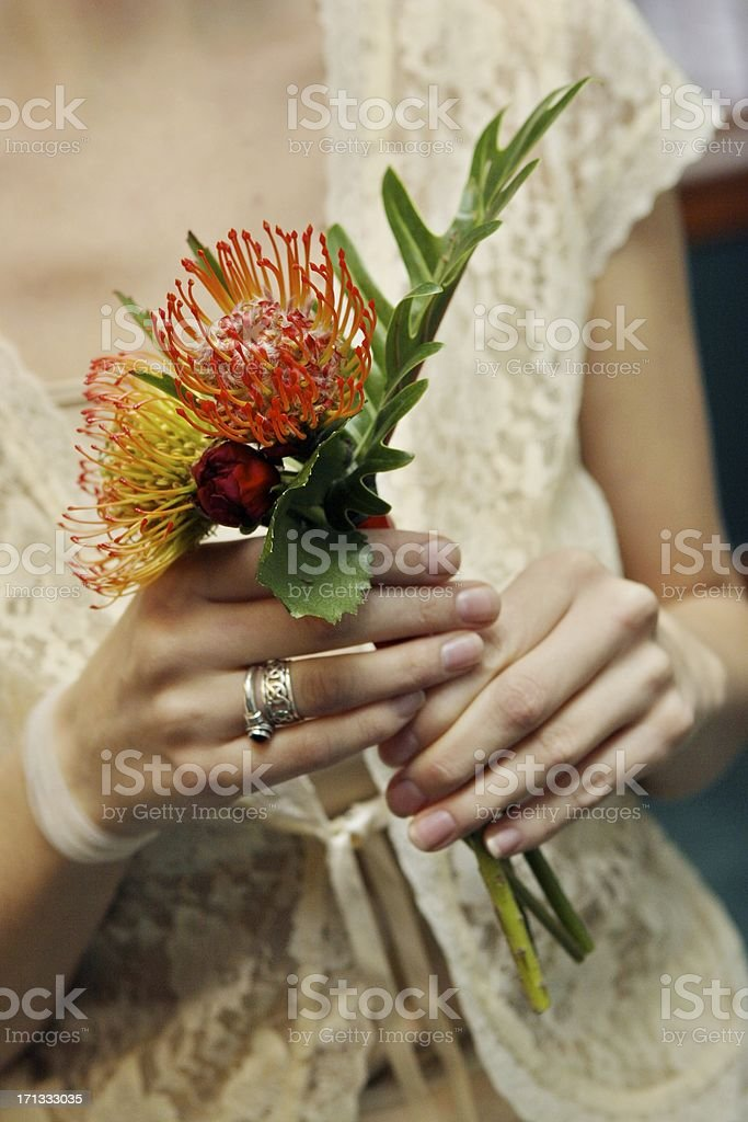 Bride in Wedding Dress Holding Small Floral Arrangement royalty-free stock photo