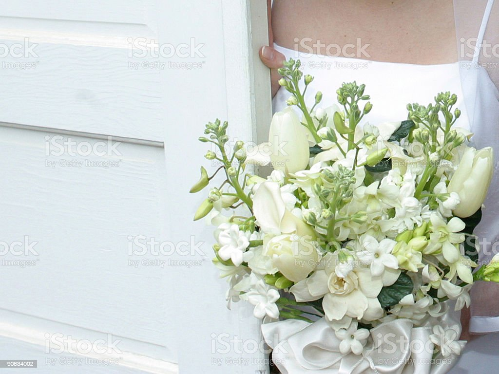 Bride in Wedding Dress with Bouquet stock photo