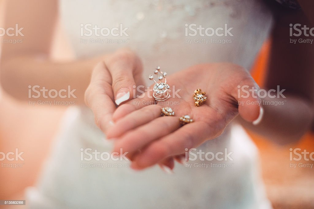 Bride is holding the beautiful  jewelry stock photo