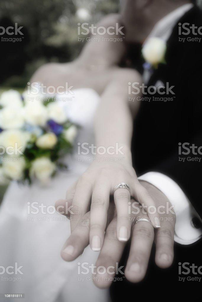 Bride Kissing Groom While Displaying Wedding Rings royalty-free stock photo