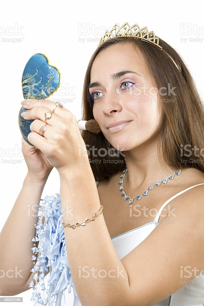 Bride look in handy mirror and make-up royalty-free stock photo