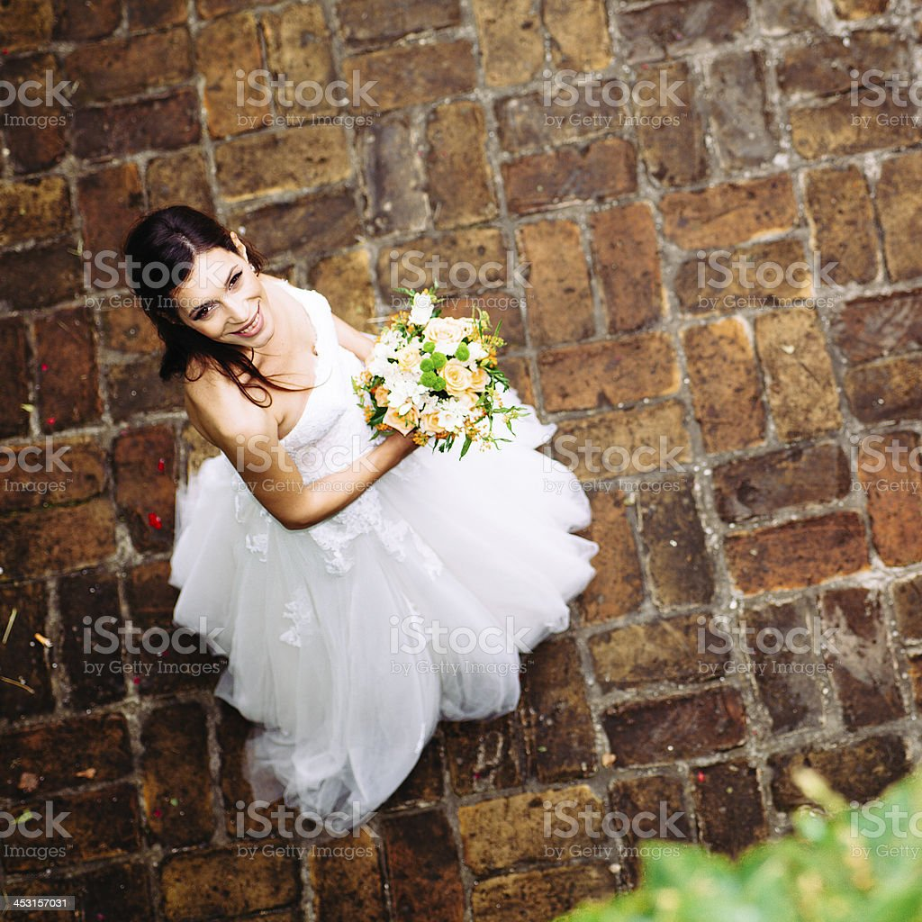 Bride looking at camera holding a wedding bouquet. royalty-free stock photo