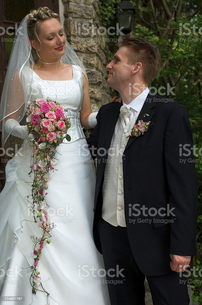 bride looking down at the groom royalty-free stock photo