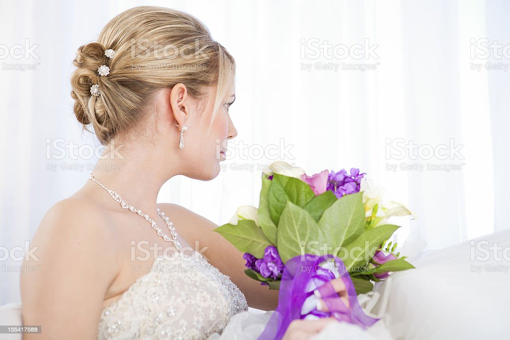 Bride looking out the window royalty-free stock photo