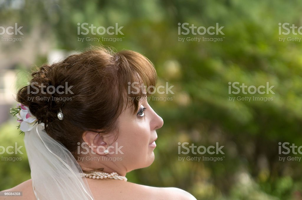Bride looking over her shoulder. royalty-free stock photo