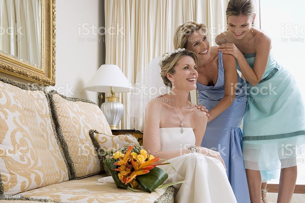 Bride maid of honour and bridesmaid laughing stock photo