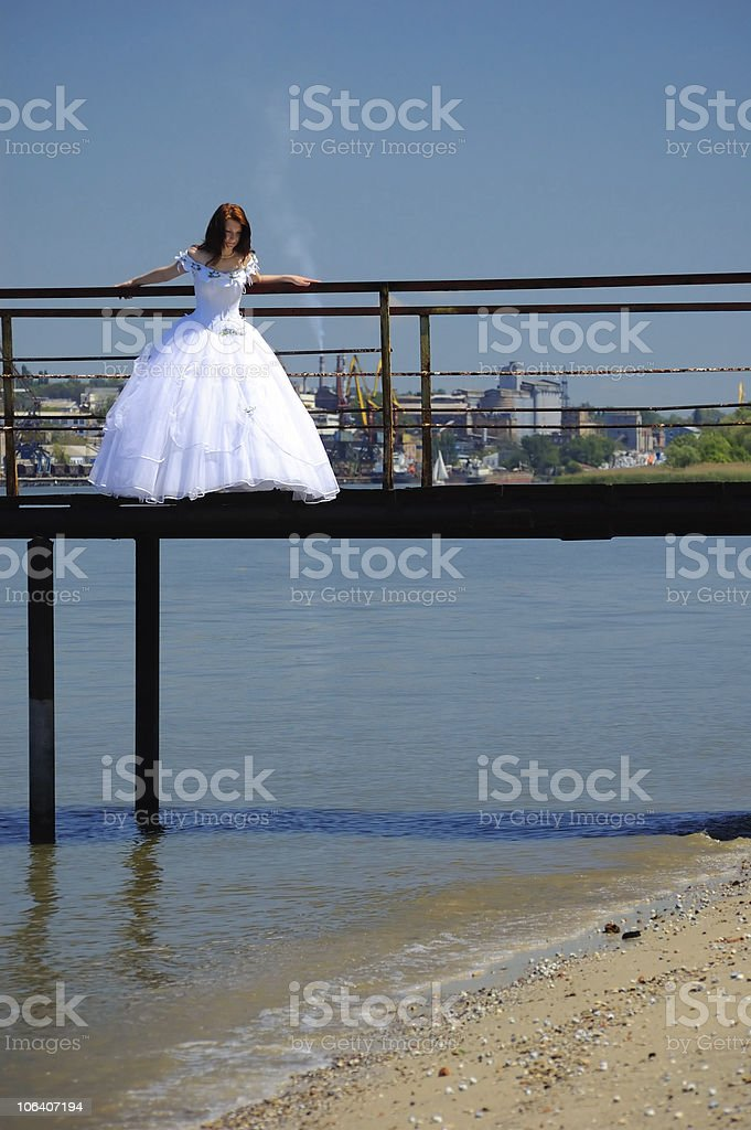 Bride on a bridge royalty-free stock photo