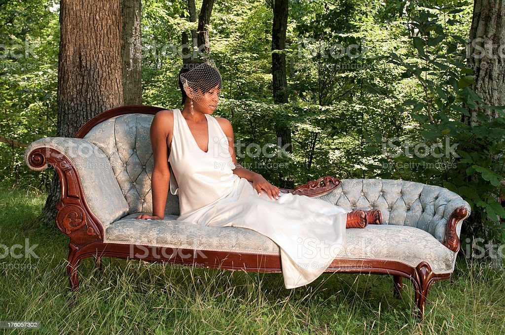 Bride on chaise lounge royalty-free stock photo