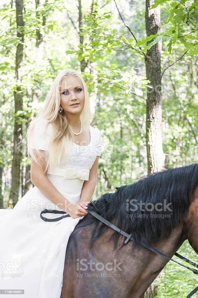 Bride on horseback royalty-free stock photo