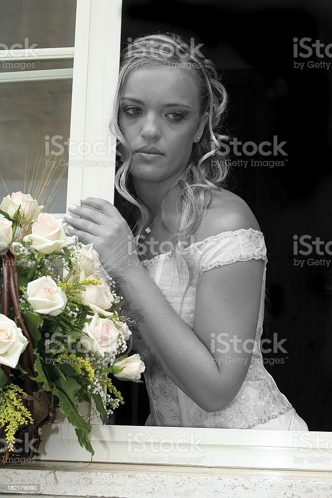 Bride  on the window royalty-free stock photo