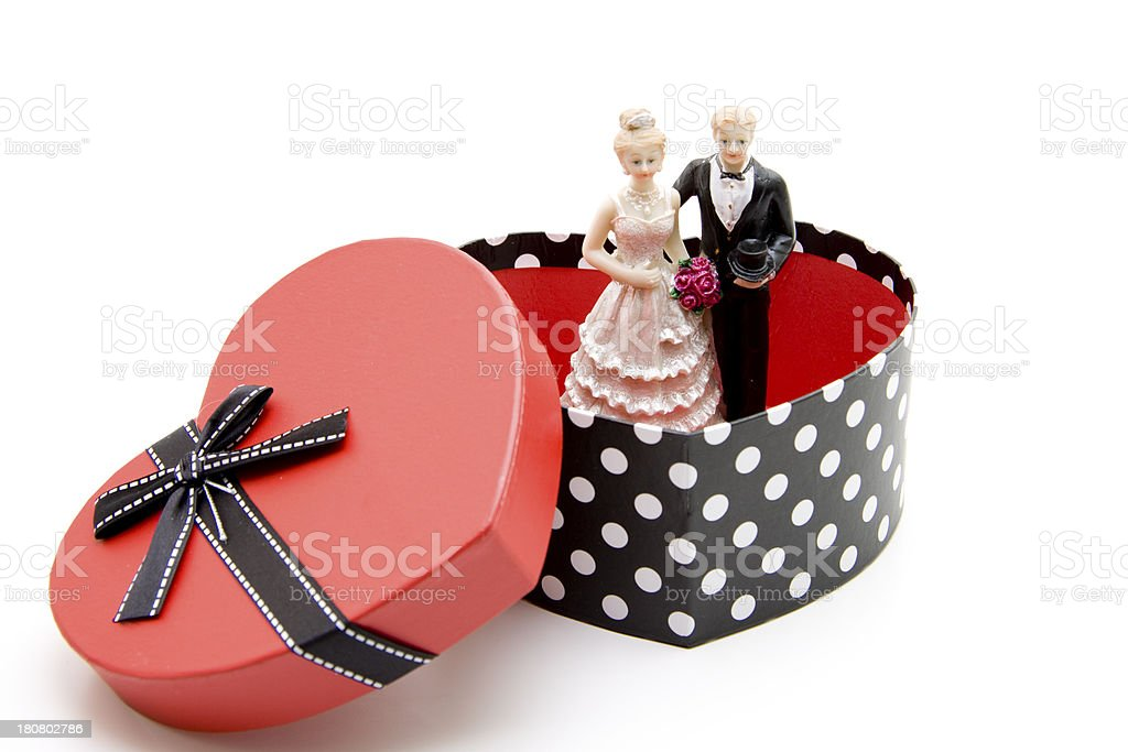 Bride pair in the heart cardboard stock photo